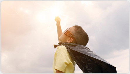feature graphic: A child in a superhero costume reaching for the sun